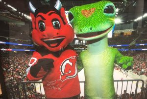 Sports Celebrity Endorsements The GEICO Gecko with the New Jersey Devils mascot